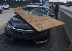Read more about the article Woman escapes scary accident when plywood slices through windshield